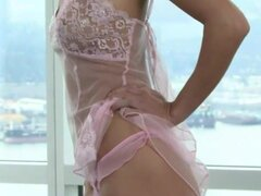 Skinny glamour girl in pink lace lingerie