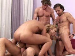 Luba Love takes on four hard cocks at one time, this whore loves it all