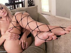Her sexy feet in fishnet stockings turns him on and he licks them while he fucks her