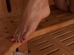 Adriana Malkova the hot blonde shows her feet in a sauna