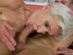 Luscious granny wraps her lips around a huge prick