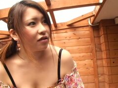 Asian babe with large tits on downblouse spy cam
