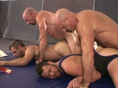 Four wrestlers in a hardcore ass-fucking gym action