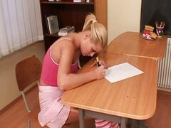 Cute blonde teen student showing