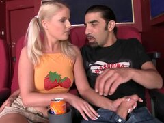 Sexy blonde teen with pigtails rides a cock in a cinema hall