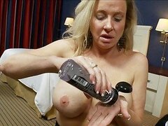 Turned on handsome cougar with big tits rides hard bazooka