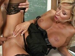 Blonde sex teacher does blowjob and fucks with two students