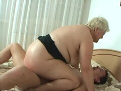 Fat blonde granny Iman rides a cock in cowgirl position