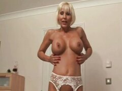 Mature lady in lingerie slaps and tugs cock