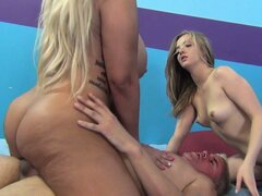 Curvaceous blondie and her slim kitty friend sharing a lover