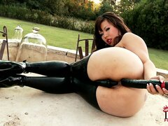 Chubby asian broad in latex stockings stuffs her ass with a dildo