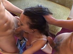 Young brunette treated rough in a threesome
