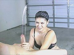 Passionate girl gives a great handjob in the shed