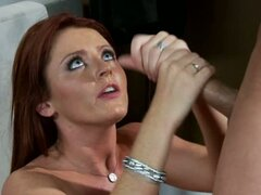 Sophie Dee loves getting coated in hot cum