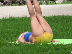 Sexy blonde MILF yoga teacher shows off her sexy body outdoors
