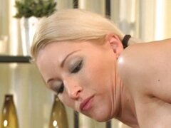 Blonde MILF rubs more than just his back