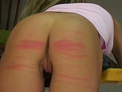 Teen ass caned in a painful video