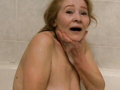 Delightful old lady with nice tits takes bath with her young lover