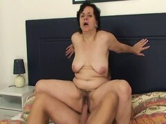 Mature jumps on his cock