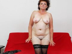 Busty mature masturbates in her stockings