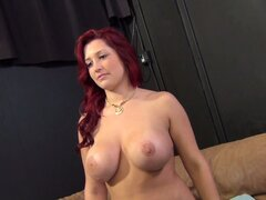 Busty redhead babe Dayna Vendetta poses and spreads to get licked