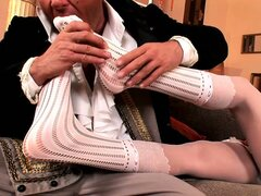 She uses her lovely silken stockings to play with her man's cock