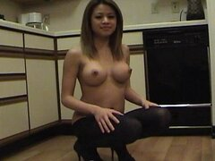 Sexy Asian Jenny wears sheer black pantyhose
