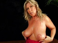 Mature mom wth big tits masturbates