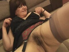 Mature busty brunette babe shows off hairy pussy