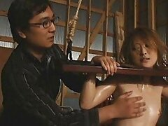 Japanese AV Model bound using rope and wood in this video