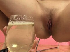 After cumming she pisses in her glass, drinks some and pours the rest on her