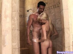 Sweet blonde teenie slurps his soapy fuck tool in the shower