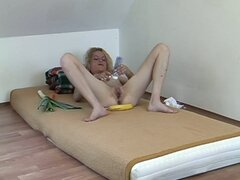 Horny blonde milf masturbating with vegetables