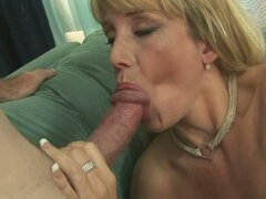 Olivia, the much practiced cock sucking MILF slobbers all over his shaft
