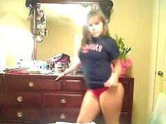 A brown-haired teen shakes her big butt in front of the webcam