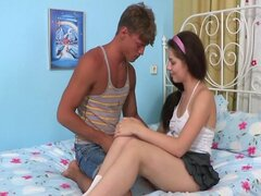 Tight brunette teenie stuffed with a cock