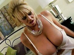 Big titty babe Kelly Madison jerking on a huge cock