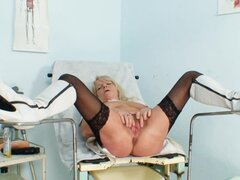 White boots on mature nurse