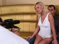 A beautiful blonde chick sits on top of a man's lap giving him a boner which he rides her with