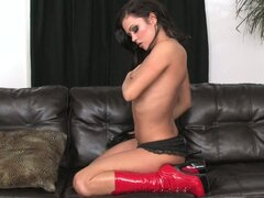 Sexy brunette in boots toys pussy