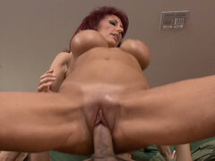Red haired girl giving a ride to a strong cock