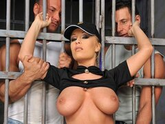A couple of randy prisoners get to double team a stunning blonde prison guard