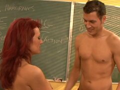 Red hair mature Nikki Sinn as a teacher takes advantage on her student and gives a blowjob