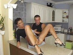 Short haired housewife does anal in kitchen