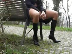Chick in boots masturbates in the park