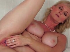 Curvy blonde mature fingers her ass sensually