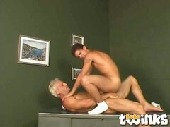 Firm bodied twink Casper riding anally a huge cock on the desk