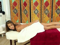 Brunette masseuse gives a sexy massage and starts rubbing the hot spots