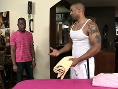 Hunky masseur rubs down some tight gay black ass...