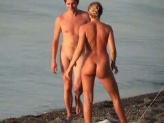 Sweet couple naked on the beach